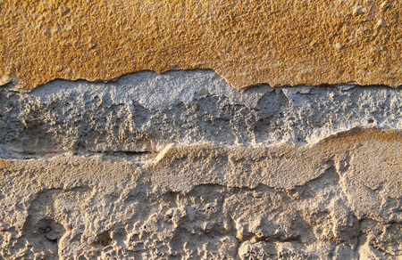 detail of the surface of the old desolated wall of a ruined house