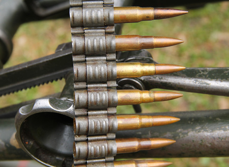 close photo of a cartrige belt with ammo for a historical machinegun from Worl War II Reklamní fotografie
