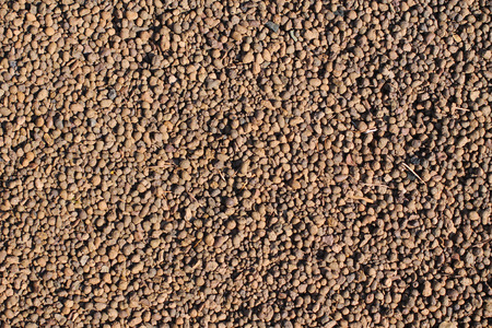 a lot of small round brown stones useful as background Stock Photo