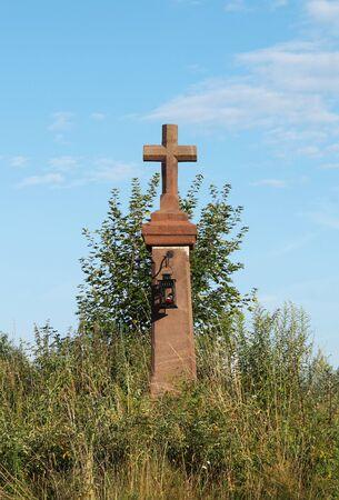 old cross with lantern among the plants, Ledecko, Czech Republic