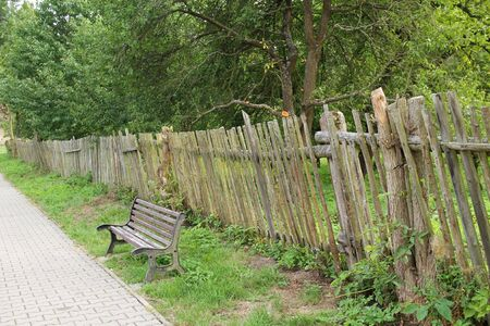 bench near the old wooden fence at the countryside
