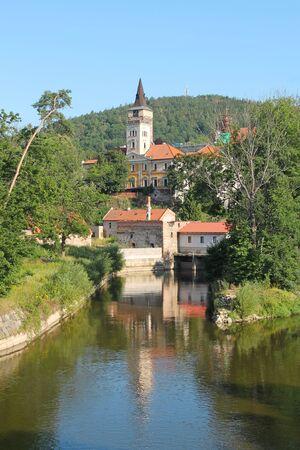 old monastery reflecting on the water surface on sunny summer day in Sazava, Czech Republic Reklamní fotografie