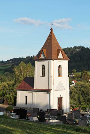 small white church at the cemetery in Vendryne, Czech Republic Reklamní fotografie