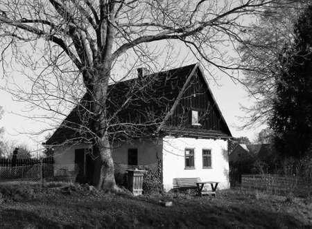 black and white photo of a nice house at the countryside in Bartosovice, Czech Republic Redakční