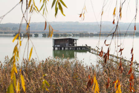 bizarre post-apo looking cottage with narrow gangplank on Hermanicky pond in Ostrava, Czech Republic