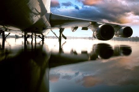 inclement: Airplane over water in the Thailand flooding at Donmaung International Airport. Stock Photo