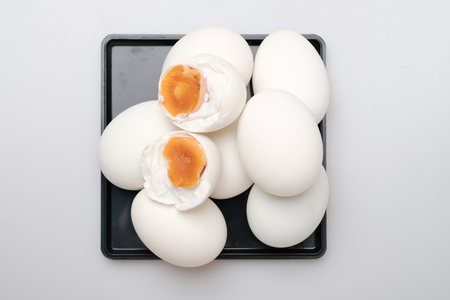 Isolated top view group of salted duck egg, preserved food made by soaking duck eggs in brine, or packing each egg in damp, salted charcoal.