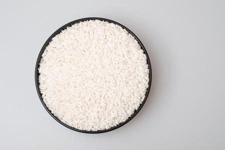 White glutinous rice isolated on white background. Top view Stock Photo