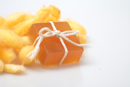 Glycerin silkworm cocoon and honey soaps with silkworm cocoons on white, handmde organic product
