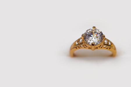 Gold wedding ring on a white background