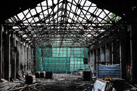 construction plant: Scaffolding Stage with green canvas in ruins, china bamboo opera building Stock Photo