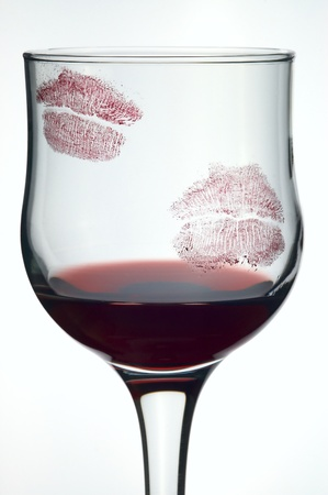 Kisses on glass with wine