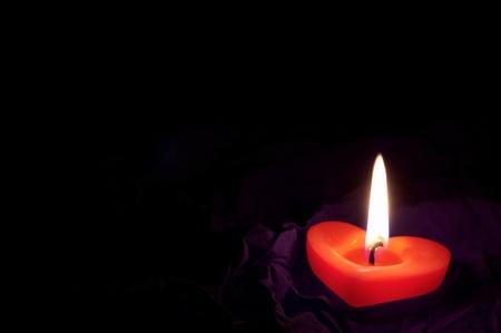 backcloth:  Coloured candle shaped heart on black backcloth