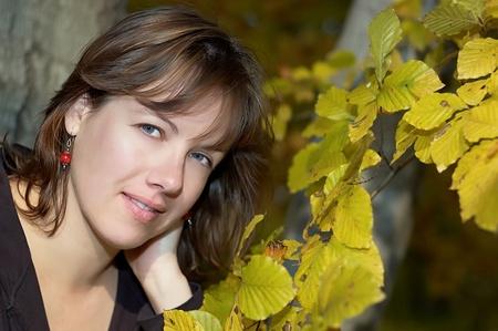 Girl near autumn tree photo