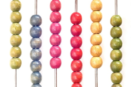 Closeup of bright abacus beads on white background  photo