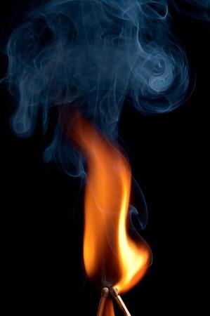 Two burning match on black background Stock Photo - 13155414