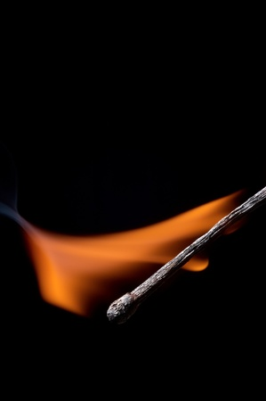 Burning matchstick on black background Stock Photo - 13298655