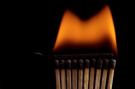 Burning matchstick on black background Stock Photo - 13298675