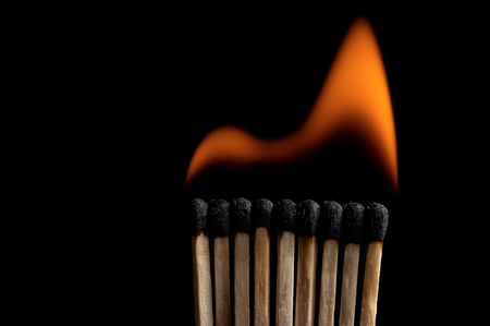 Burning matchstick on black background Stock Photo - 13298669