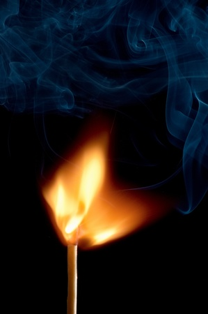 Burning matchstick on black background Stock Photo - 13298687