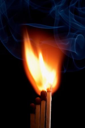 Burning matchstick on black background Stock Photo - 13298683