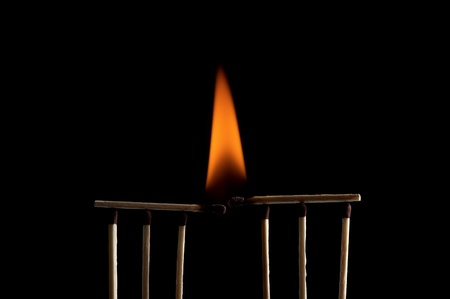 Burning matchstick on black background Stock Photo - 13298643