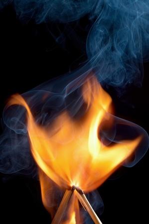 Burning matchstick on black background Stock Photo - 13298700