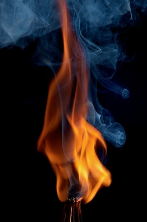 Burning matchstick on black background Stock Photo - 13298686
