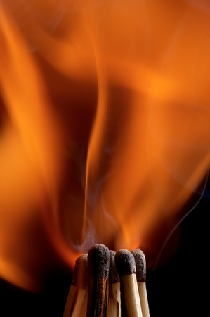 Burning matchstick on black background Stock Photo - 13298694