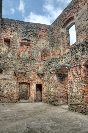 The hole in the wall of windows and stone photo