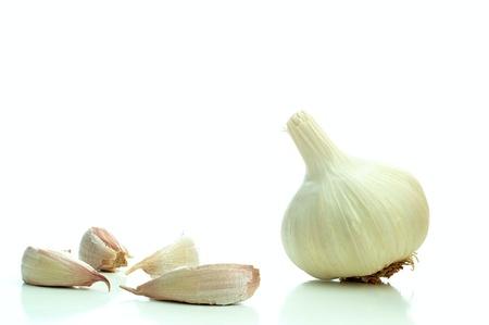 Single whole garlic on a white background photo