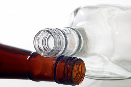 Two empty bottles lying on a white background Stock Photo - 14236482