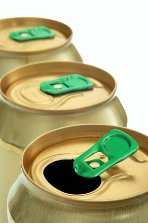 three gold-colored cans in a row photo