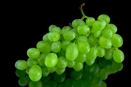 lying grapes with black background photo