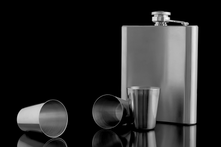 hip flask with cups on a black background Stock Photo - 17245550