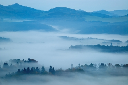 autumn morning hilly landscape with fog photo