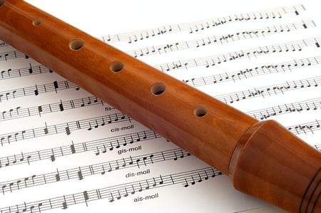 stanza: wooden flute lying on musical notation Stock Photo