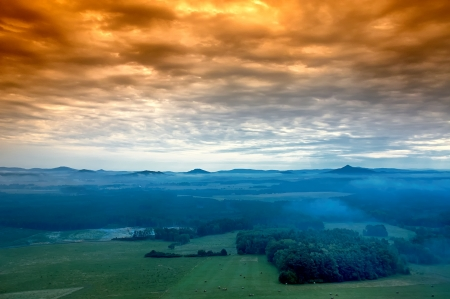 morning awakening landscape with hills and mist photo