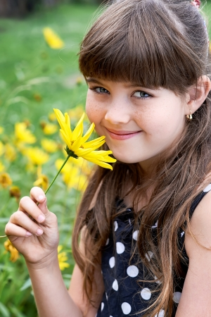 Portrait of young girl with yellow flowers Stock Photo
