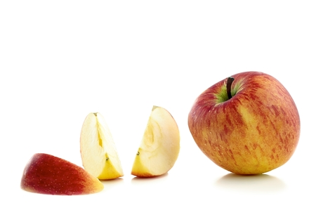 Slices of apple with a whole apple on a white background photo