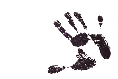 Detail print of the black hand on white background photo