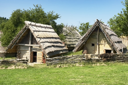 Two ancient dwelling with blue sky in the background Stock Photo - 25759540