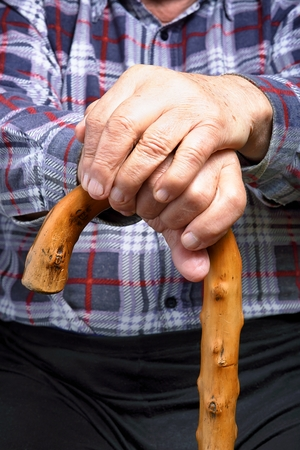 Old man holding a stick photo