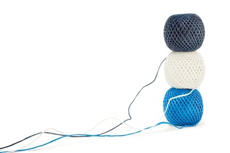 Three ball of twine on a white background