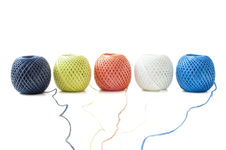 Five ball of twine on a white background photo