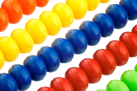 figuring: Abacus of many colorful beads on white background Stock Photo