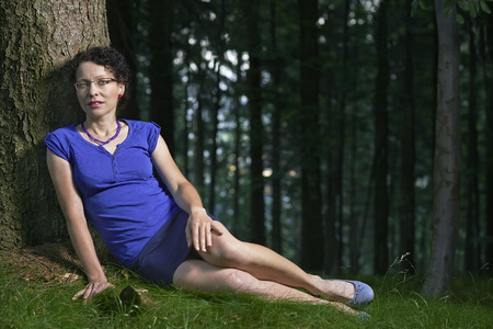 czech women: Young woman sitting at a spruce tree