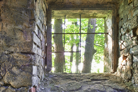 gaol: View of the old barred window and trees Stock Photo
