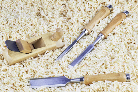 chisels: Three chisels and one spokeshave lying in wooden shavings