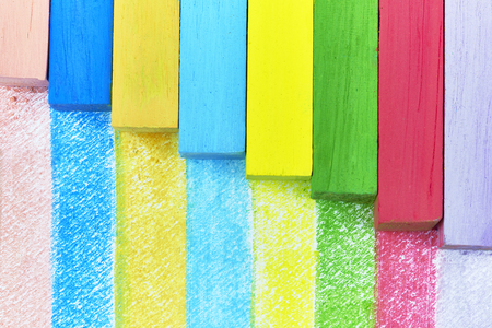 chalks: Detail of different colored chalks color painting on paper